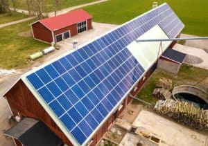 top view solar panels of farm building 300x211
